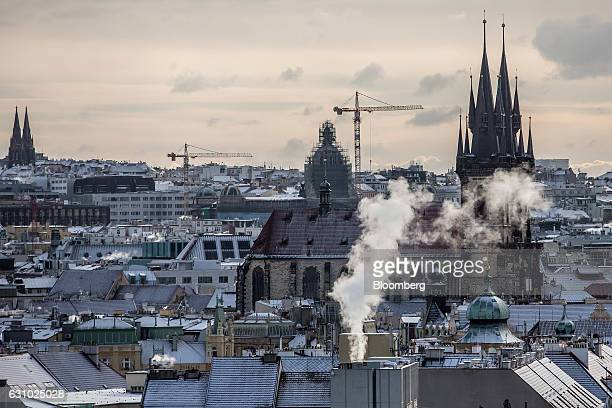 The Church of Our Lady before Tyn right stands among residential and commercial property on the city skyline in Prague Czech Republic on Thursday Jan...