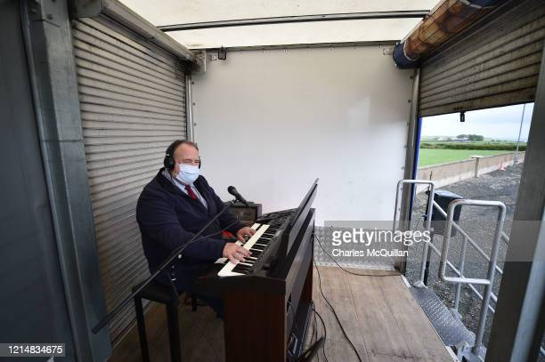 The church organist plays for the congregation during a drivein Sunday church service at Dunseverick Baptist Church on May 24 2020 in Bushmills...