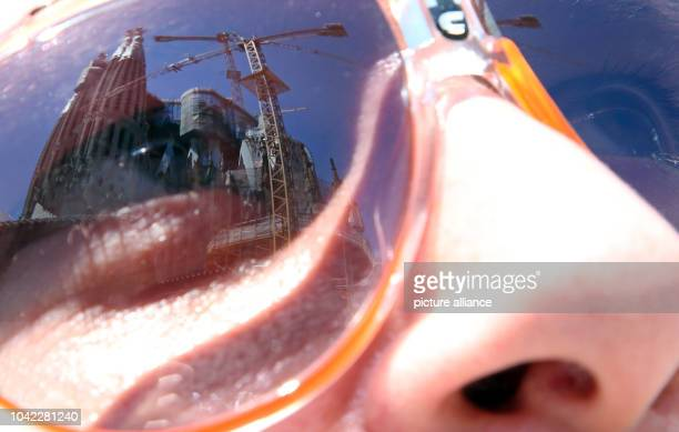 The church Sagrada Familia is mirrored in sunglasses during the 15th FINA Swimming World Championships in Barcelona, Spain, 31 July 2013. Photo:...