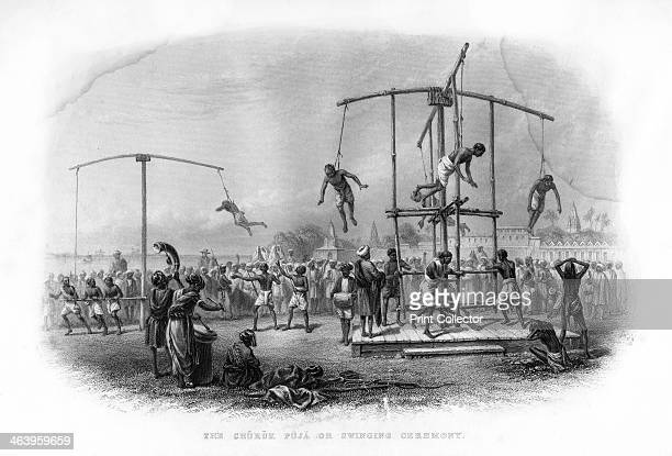 The Churuk Puja or Swinging Ceremony India 19th century Hindus swing on the ends of ropes attached by hooks through their skin A contemporary source...