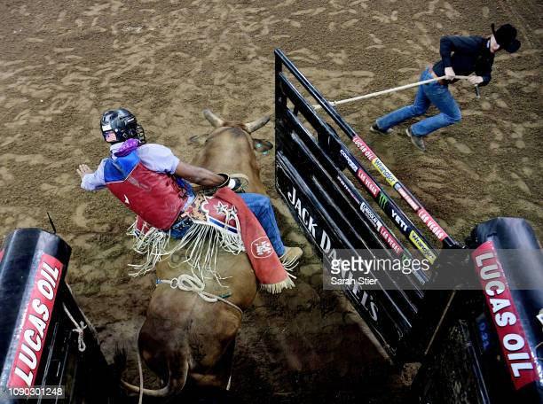 The chute is opened as Alisson De Souza rides Slam Dunk during the PBR Unleash the Beast bull riding event at Madison Square Garden on January 05...