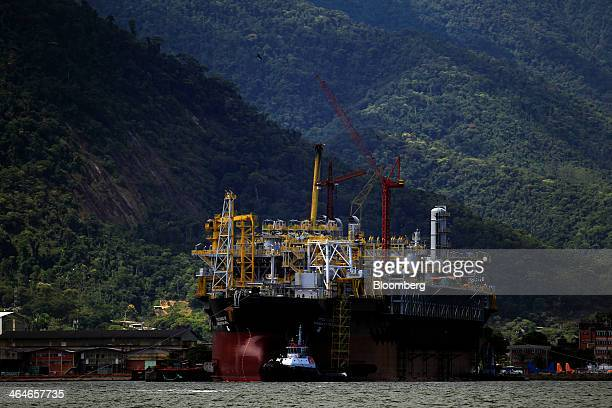 The Cidade de Mangaratiba floating production, storage, and offloading vessel sits under construction at the Keppel Brasfels shipyard in Angra dos...