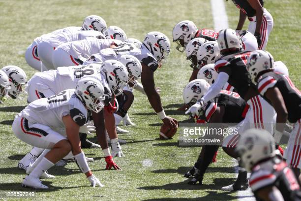 The Cincinnati Bearcats and Austin Peay Governors line up for a play during the game against the Austin Peay Governors and the Cincinnati Bearcats on...