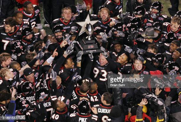 The Cincinnati Bearcats celebrate with the game trophy after defeating the Marshall Thundering Herd 3214 in the PlainsCapital Fort Worth Bowl on...