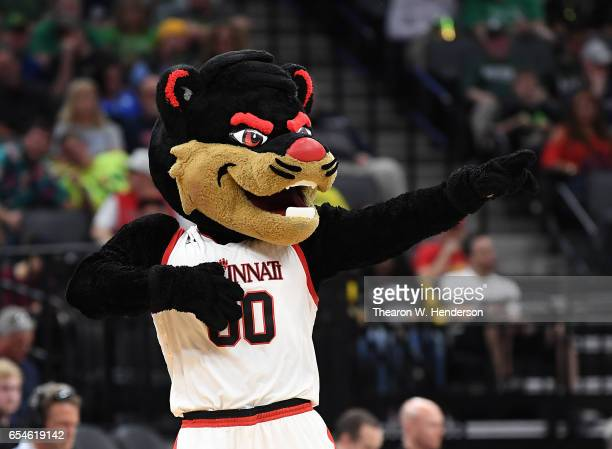 The Cincinnati Bearcats mascot performs against the Kansas State Wildcats during the first round of the 2017 NCAA Men's Basketball Tournament at...
