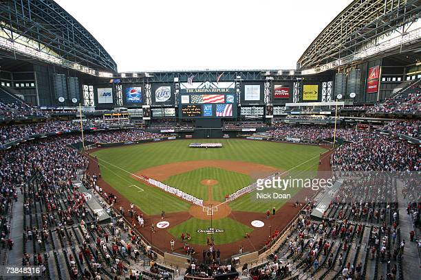 The Cincinnati Reds and Arizona Diamondbacks line up for the National Anthem before the Opening Day game on April 9, 2007 at Chase Field in Phoenix,...