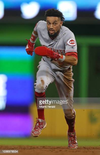 The Cincinnati Reds' Billy Hamilton advances to third base after a throwing error by Miami Marlins catcher JT Realmuto during the third inning at...