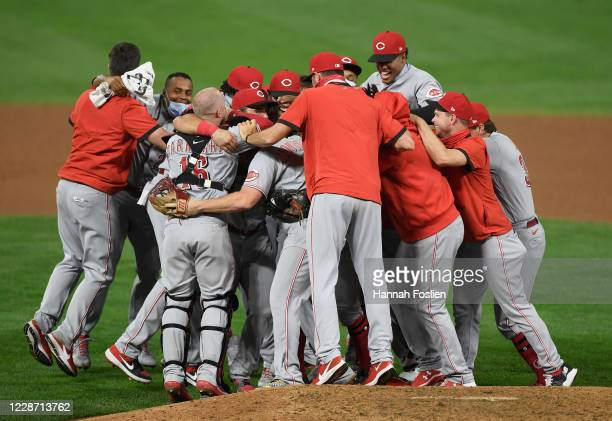 The Cincinnati Reds celebrate defeating the Minnesota Twins in the game at Target Field on September 25, 2020 in Minneapolis, Minnesota. The Reds...