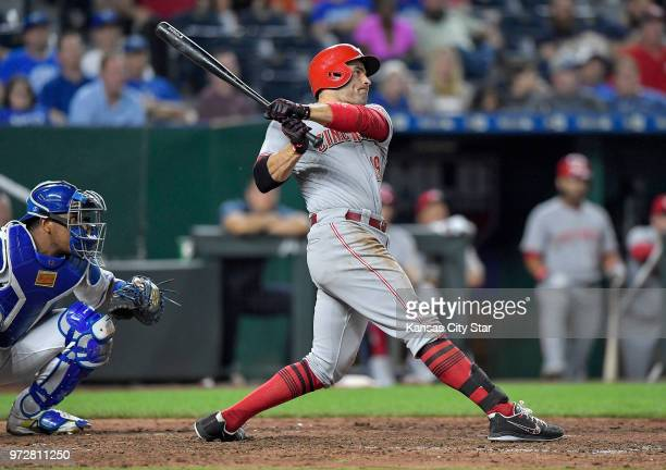 The Cincinnati Reds' Joey Votto follows through on a threerun triple in the 10th inning against the Kansas City Royals on Tuesday June 12 at Kauffman...