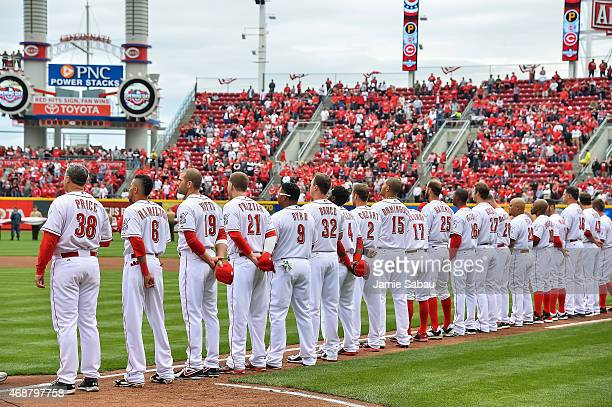 The Cincinnati Reds line up for introductions before their Opening Day game against the Pittsburgh Pirates at Great American Ball Park on April 6...