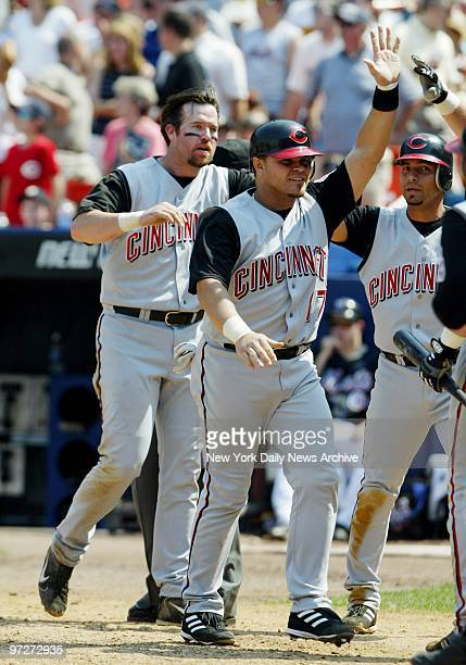 The Cincinnati Reds' Sean Casey and Javier Valentin celebrate after scoring in the seventh when New York Mets' center fielder Mike Cameron lost a fly...