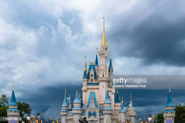 The Cinderella Castle during an overcast day is seen in the Walt Disney's Magic Kingdom theme park. The park is a famous place and tourist attraction.