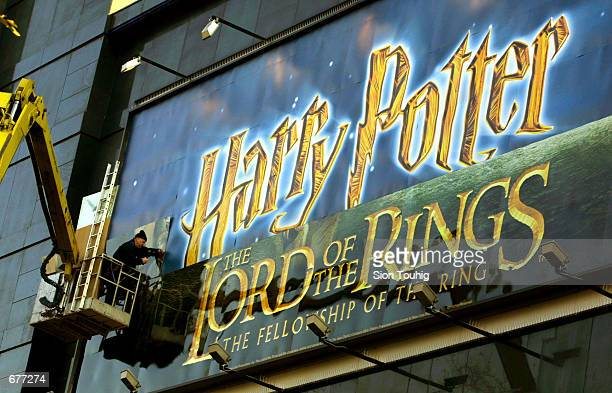 The cinema sign for the film Harry Potter is replaced by the new Lord of the Rings movie poster in preparation for the film's World Premiere at the...