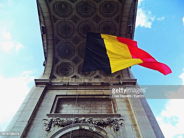 The Cinquantenaire Triumphal Arch With Flag Of Belgium