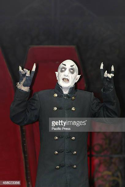 The 'Circo de Los Horrores' artist comes to perform for an exhibition in Naples The scary vampires demons stone statues wreaths tombstones and...
