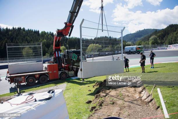 The circuit staff at work in order to put in safety measures on corner number 3 during the MotoGP Of Styria - Previews at Red Bull Ring on August 20,...