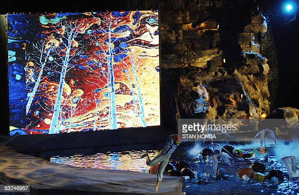 The Cirque du Soleil performs before a giant video screen at the opening ceremonies 16 July 2005 for the 2005 XI FINA World Championships that will...