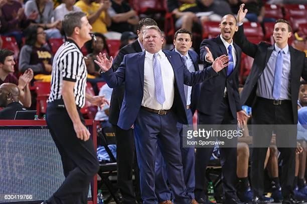The Citadel Bulldogs coach Duggar Baucom and his coaching staff react to a non call during the NCAA basketball game between the Citadel Bulldogs and...