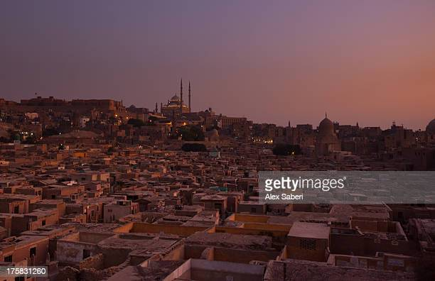 the citadel in cairo at dusk with the mohammed ali mosque. - alex saberi stock pictures, royalty-free photos & images