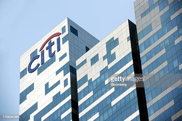 The Citigroup Inc logo is displayed atop Tower 1 of Asia Square in Singapore on Friday June 14 2013 Singapore's central bank plans to reprimand banks...