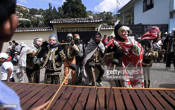 The citizens of Acatenango Chimaltenango departament dance to the 'marimba' music with their faces covered with masks to receive the New Year 01...