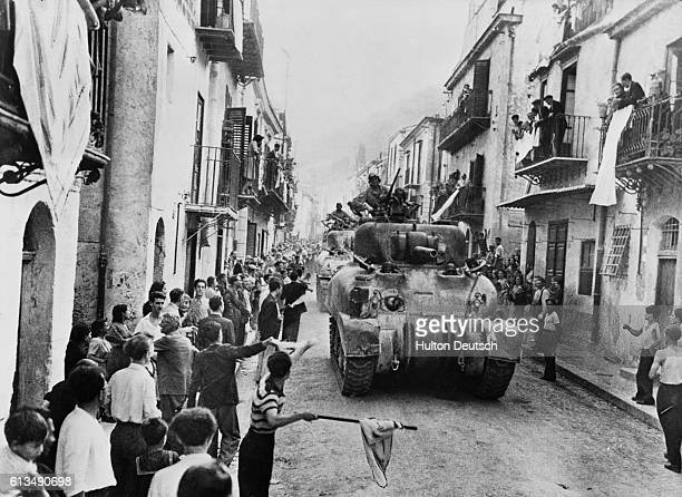 The citizens of Palermo Sicily welcome American tanks into their city after surrendering to the Allied forces