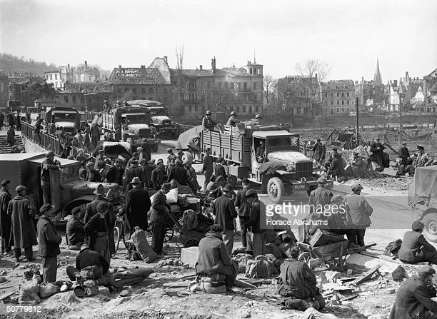 The citizens of Saarbrucken sit amidst the ruins of their city captured by the American 7th Army during World War II September 1945