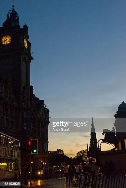 The city centre of Edinburgh in early autumn, during sunset. Visible are the North British Hotel clock tower, the Scott Monument in the middle and a...
