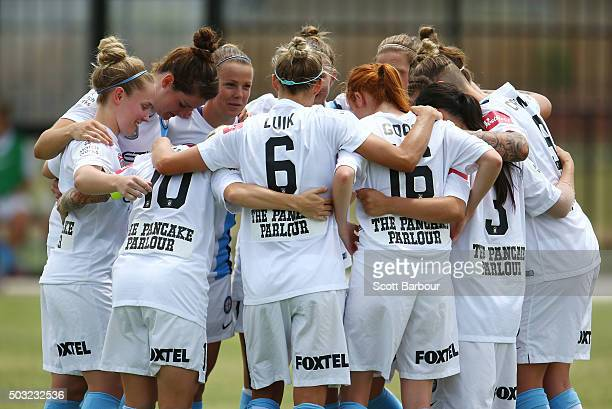 The City FC team form a huddle during the round 12 WLeague match between Melbourne City FC and the Western Sydney Wanderers at CBSmith Reserve on...