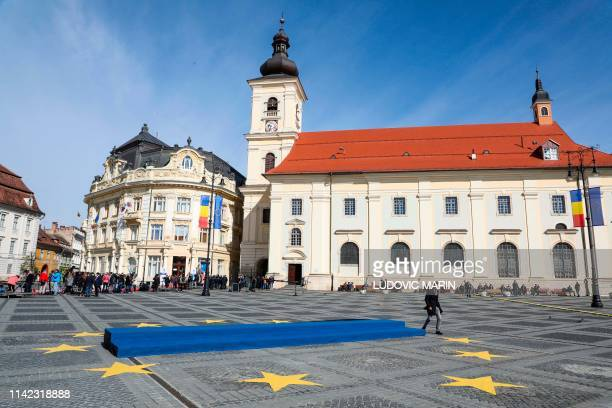 The city hall and the Catholic Church are seen at Sibiu's Piata Mare as it is being decorated ahead of a European Summit on May 9 2019