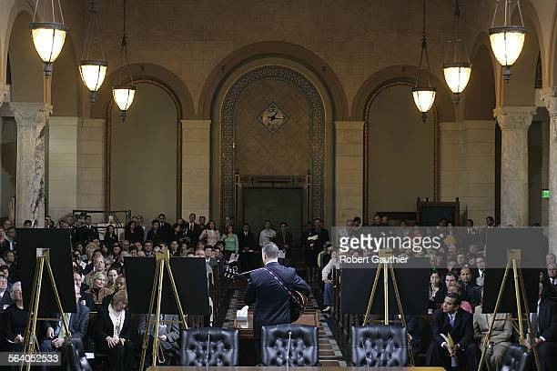 The LA City Hall council chambers is full Thursday February 24 with mourners during service for LA Department of Public Works supervisor Rory Shaw...