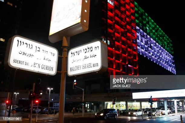 The city hall in the Israeli coastal city of Tel Aviv is lit up in the colours of the United Arab Emirates national flag on August 13, 2020. - Israel...