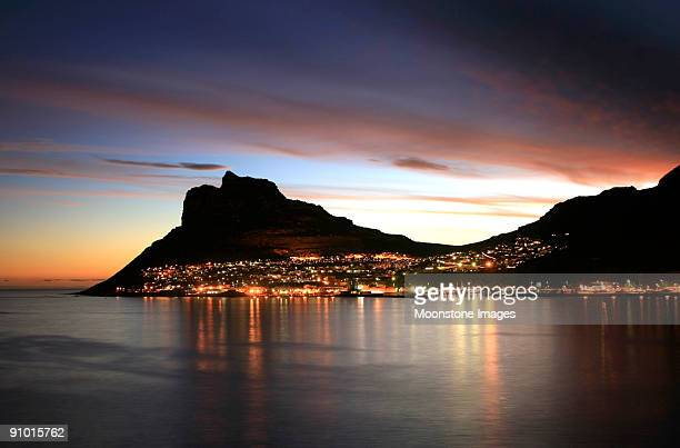 The city lit up at sunset in Hout Bay