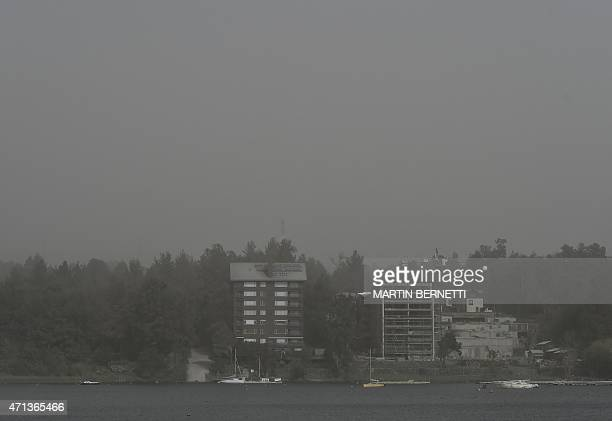 The city looks foggy because of the ash spewed by the 400kilometre distant Calbuco volcano in Pucon southern Chile on April 27 2015 More than 6500...
