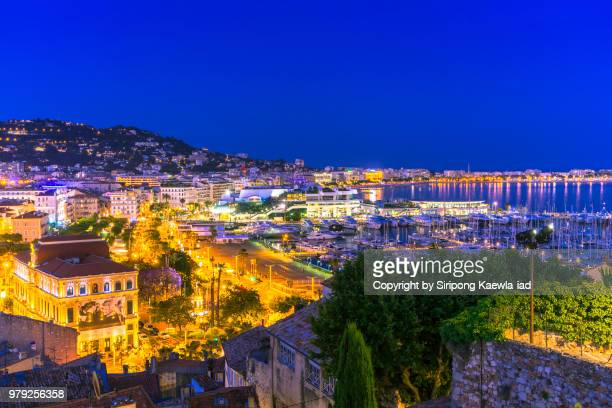 the city night light in cannes, france. - cannes stock pictures, royalty-free photos & images