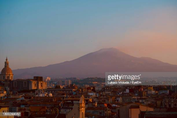 the city of catania in sicily, volcano etna. - catania stock pictures, royalty-free photos & images