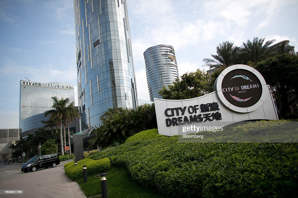The City of Dreams complex, operated by Melco Crown Entertainment Ltd., stands in Macau, China, on Wednesday, Feb. 6, 2013. Casino industry revenue in the gambling hub climbed 14 percent to a record 304 billion patacas ($38 billion) last year. Photographer: Lam Yik Fei/Bloomberg via Getty Images