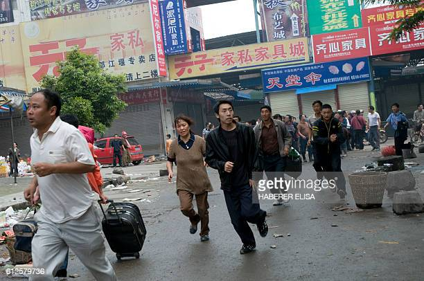 The city of Dujiangyan affected by a 79 magnitude earthquake is the most important city close to the epicentre Inhabitants running in the streets...