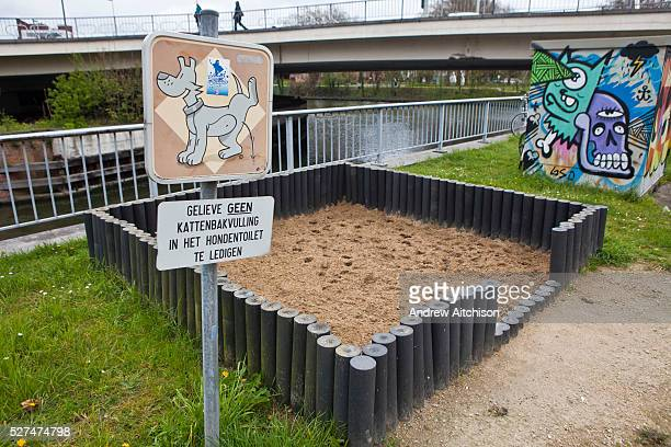 The city of Ghent provides walled sand pits for dogs to urinate and poo in This is for hygiene purposes so that dogs don't urinate and poo on the...