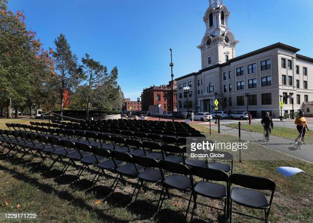The city of Lawrence is honoring victims of COVID-19 with a memorial of empty chairs across the street from City Hall in Lawrence, MA on Oct. 15,...