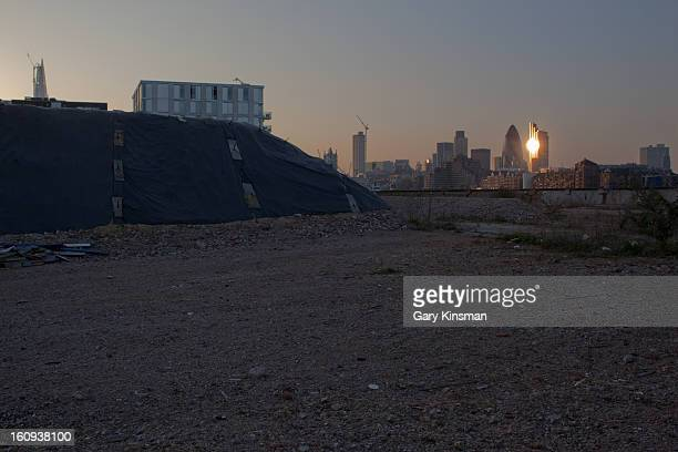 CONTENT] The City of London skyline and the Shard at sunset taken from the Chambers Wharf site in Bermondsey in 2012