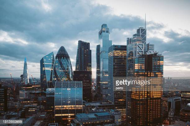 the city of london skyline at night, united kingdom - greater london stock pictures, royalty-free photos & images