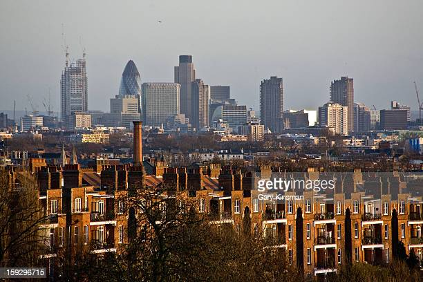 CONTENT] The City of London skyline including the under construction Heron Tower seen from Hampstead Heath North London
