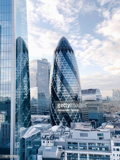 the city of london skyline with the gherkin skyscraper - financial district stock pictures, royalty-free photos & images
