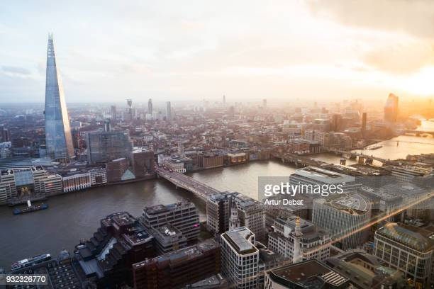 the city of london skyline with the shard tower during sunset with blue and orange colors. - shard london bridge stock pictures, royalty-free photos & images