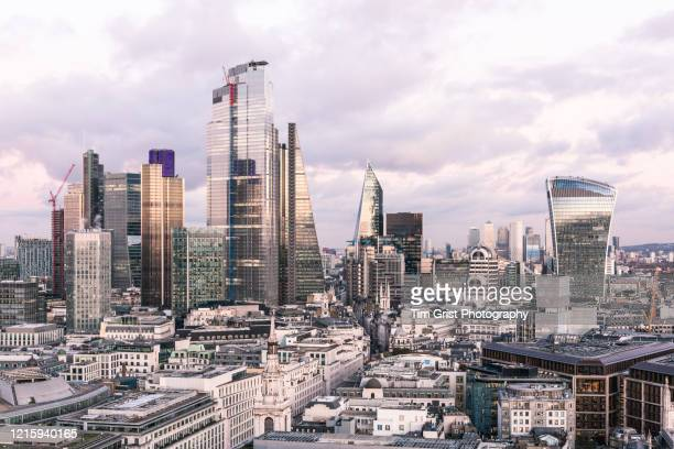 the city of london's financial district skyline - corona landmarks stock pictures, royalty-free photos & images