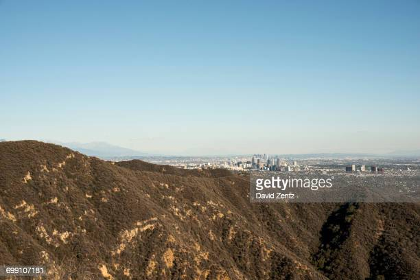the city of los angeles is seen from the santa monica mountains. - los angeles mountains stock pictures, royalty-free photos & images