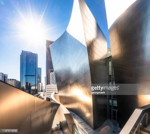 the city of los angeles with the walt disney concert hall in the foreground - walt disney concert hall stock pictures, royalty-free photos & images