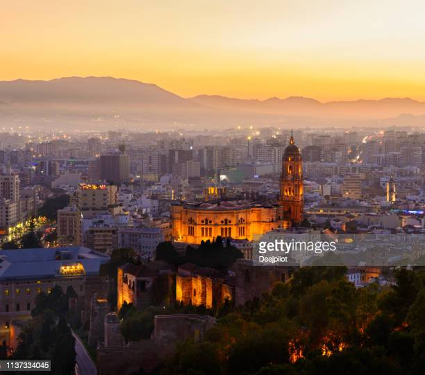 the city of malaga at sunset, andalusia, spain - málaga málaga province stock pictures, royalty-free photos & images