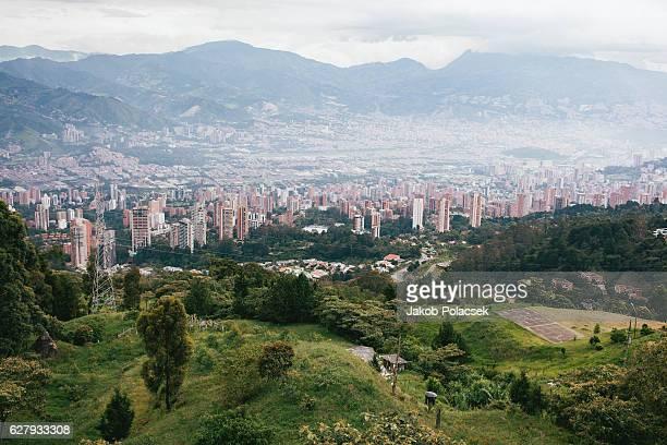 the city of medellin seen from the surrounding hills. - medellin colombia fotografías e imágenes de stock